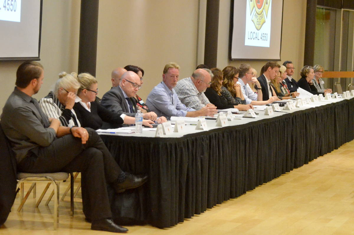 The 23 candidates who arrived at the all-candidates meeting Thursday for the Township council and mayoral races. (Matthew Claxton/Langley Advance)