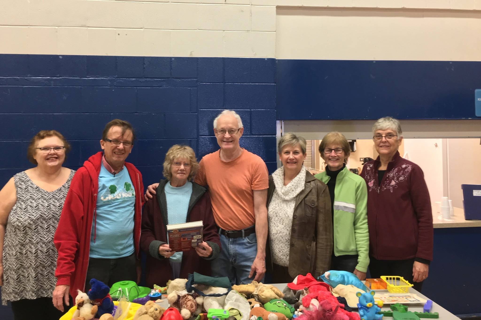 Founder and President of Clothes2U, Ernie Jantzen (second from left) and his volunteers, Deby, Verna, John, Jenny, Linda and Maria (left to right) pose at Nicomekl Elementary in Langley for their giveaway (Photo by Kieran O'Connor/Black Press Media)