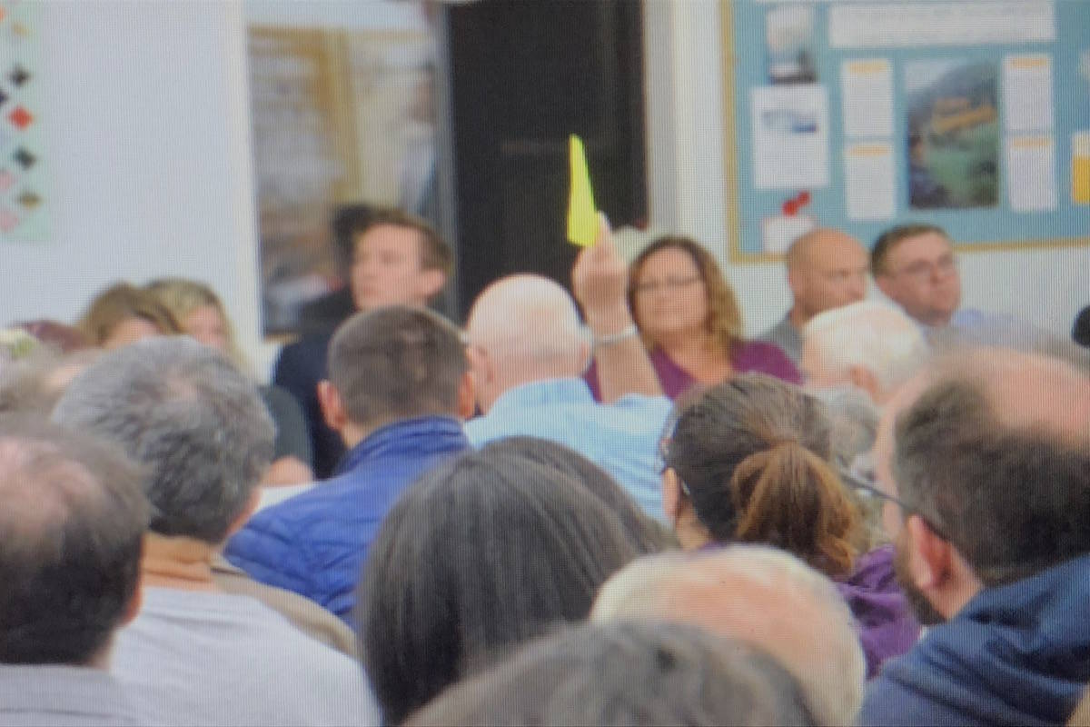 The Willoughby Residents' Association hosted an all-candidate forum Thursday evening with tightly timed segments and a volunteer holding up a yellow flag to show candidates they were at their time limit.