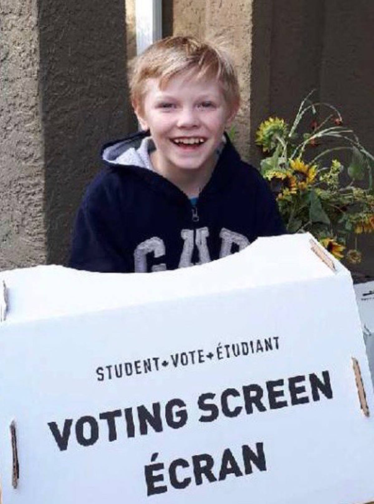 Ajay Teschier, eight, was all smiles after he voted in an impromptu mock election in Brookswood Thursday. (Special to the Langley Advance)