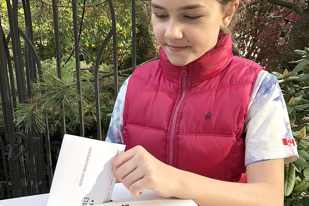 Brookswood's Judi Vankevich offered a civics lesson to young kids she knew, then set up a fake voting station in her backyard. Among those participating in Thursday's mock election was 10-year-old Sophie Bouchard. (Special to the Langley Advance)