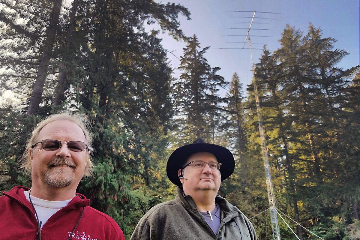 Jamboree organizers Greg Kear and Edward Vandeyck set up a 100-foot-tall radio tower for the annual jamboree at Camp McLean. (Dan Ferguson/Black Press)