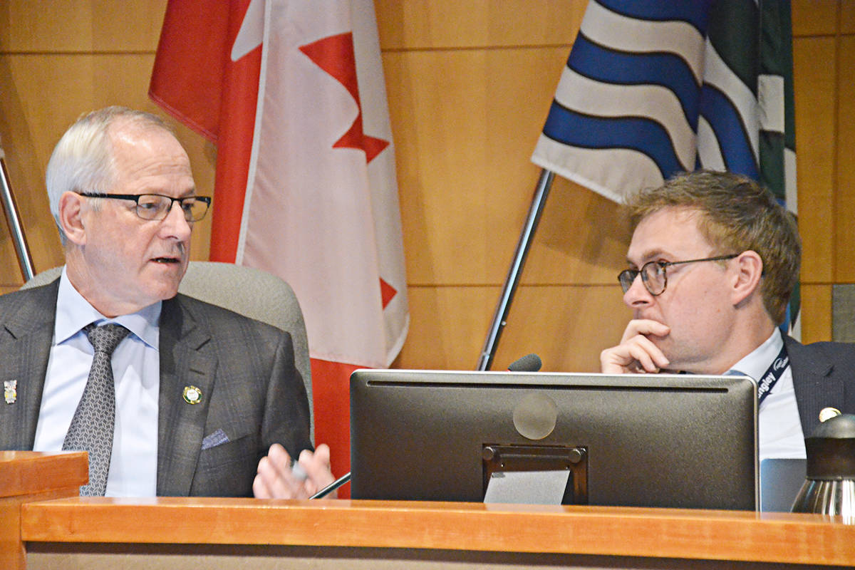 Coun. Eric Woodward (right) talked to Mayor Jack Froese before the Monday council meeting. (Matthew Claxton/Langley Advance)