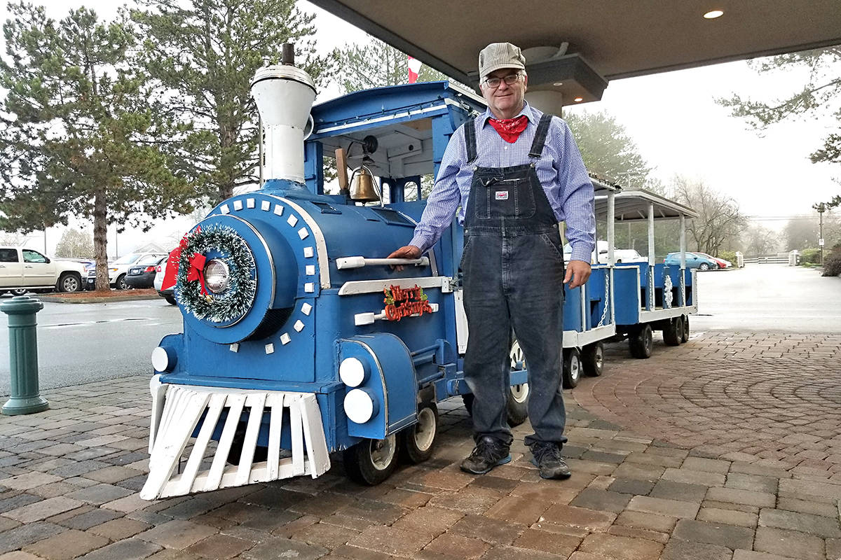 Keith Drummond provided a ride on a 35-year-old trackless train at Breakfast With Santa. Black Press Photo