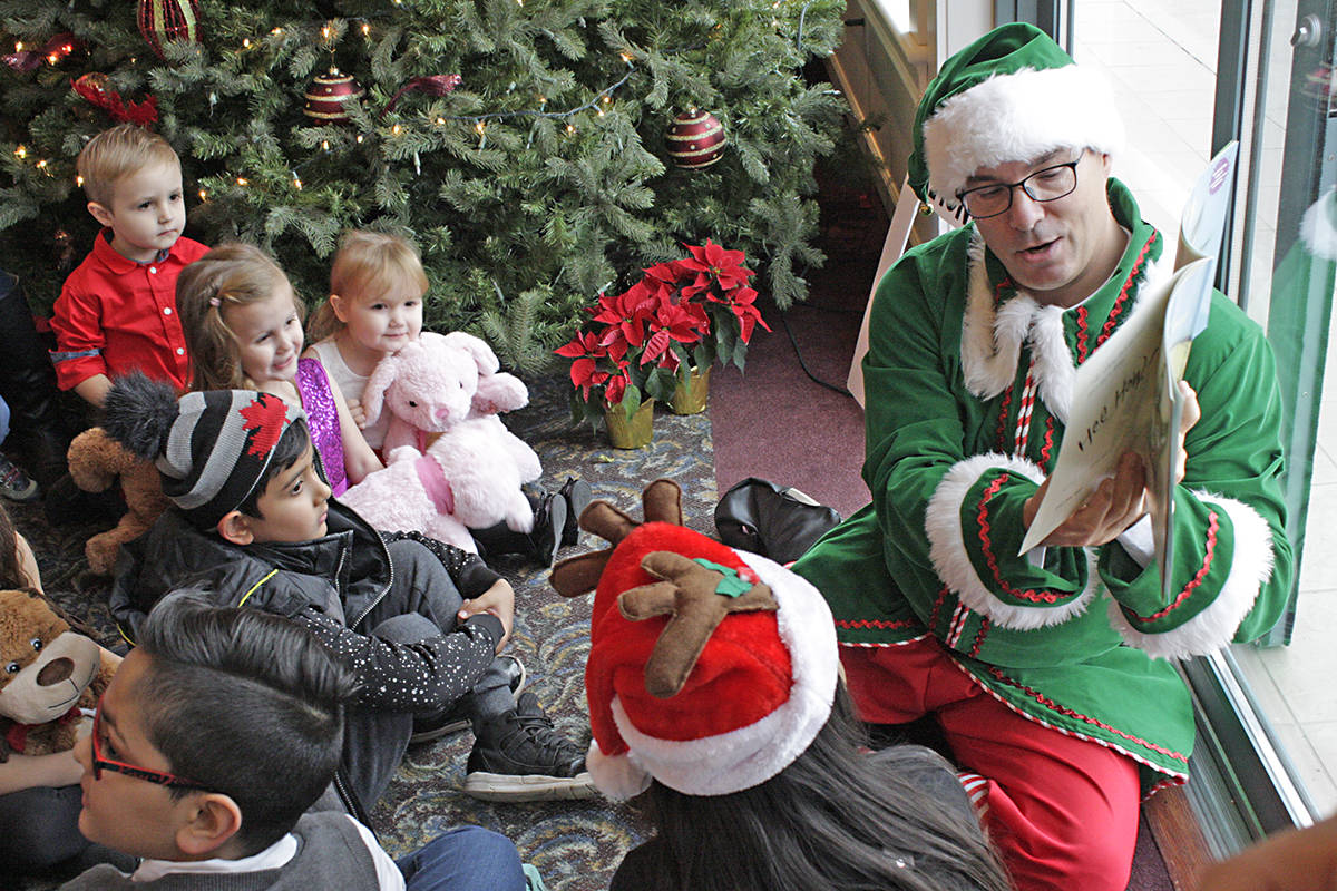 An elf reads holiday stories. Black Press photo