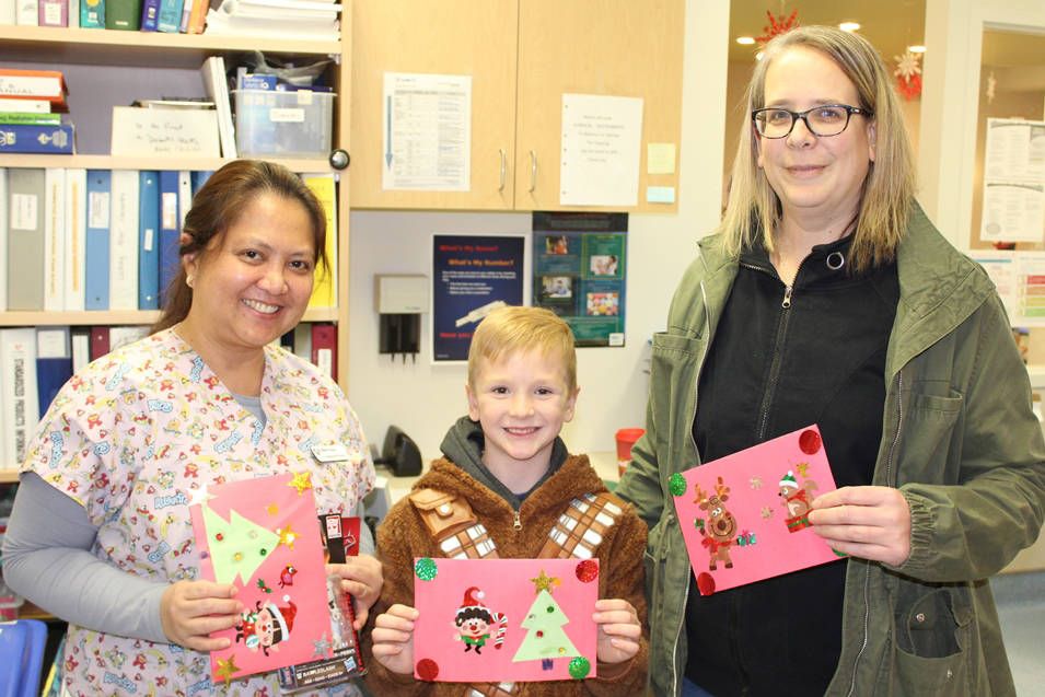 Local boy shares gift of Christmas with Langley hospital patients