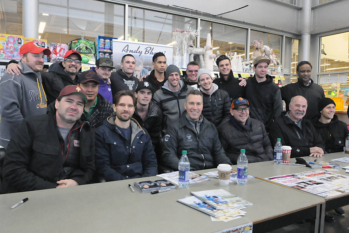 Members of a recovery program, who agreed their picture could appear in the newspaper, pose with celebrities at the Celebrity Food Drive. Black Press photo