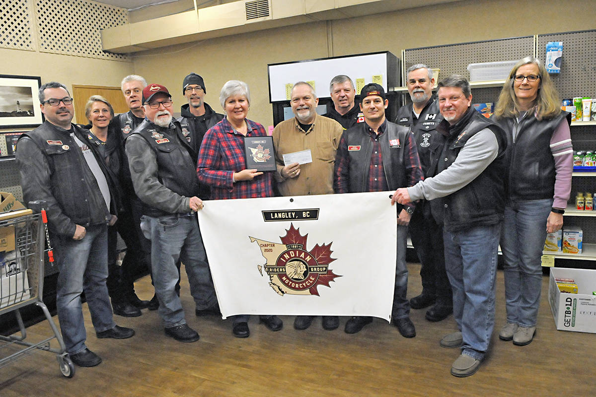 Members of the Langley-based Indian Motorcycle Riders group dropped by the Langley Food Bank Saturday with donations of cash, supplies and a plaque of appreciation. Black Press photo