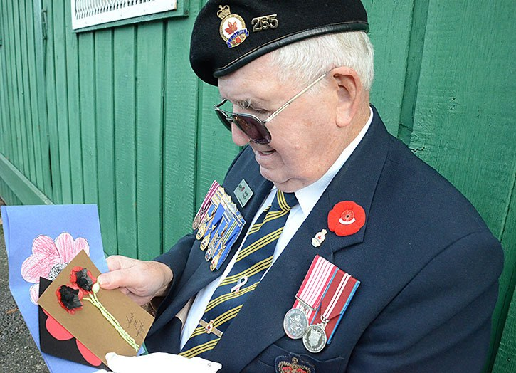 Children made thank-you cards for the Aldergrove Remembrance Day services. Walter Poustie cherishes the children's work.