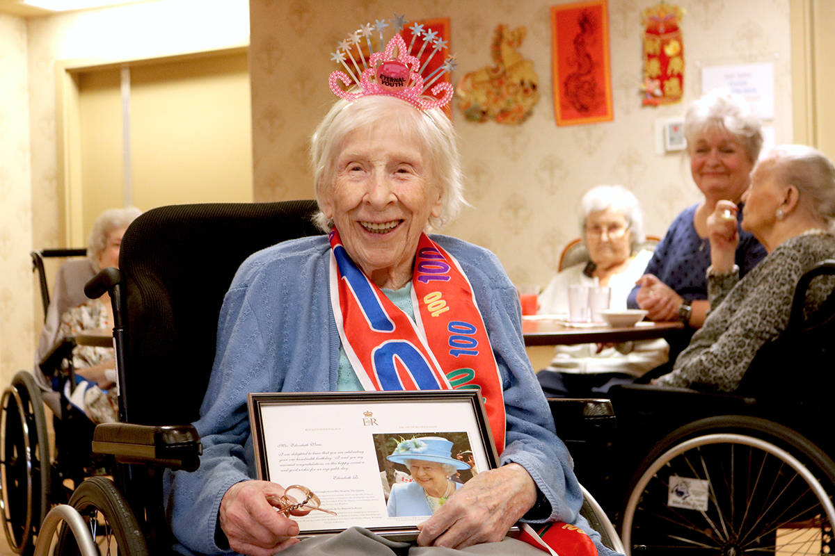 """Elizabeth Viens celebrated her 100th birthday, complete with a party hat reading """"eternal youth"""" and a birthday sash. Miranda Fatur Black Press Media"""