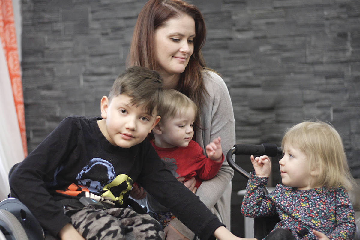 L to right: Thaddeus, mom Candice, youngest brother Frankie and Violet The Variety Children's Charity, funds leg and back braces and the lightweight wheelchairs that Thaddeus and Violet require. Black Press Media photo