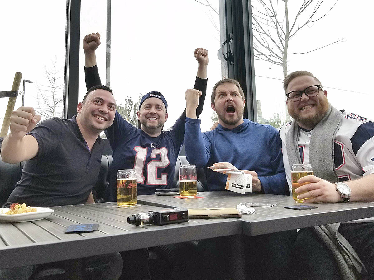 Dozens of sports enthusiasts gathered at Match Eatery Sunday to watch the Super Bowl 53 game between the Patriots and Rams, including this foursome of football fans. (Dan Ferguson/Black Press)