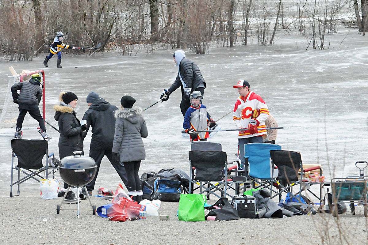 For the last four years, a group of Langley families has been coming to Dale Ball Passive Park when the ponds freeze up to skate and have a barbecue. They were back this year, even though pond skating is now banned under a new Township bylaw. Black Press Media photo