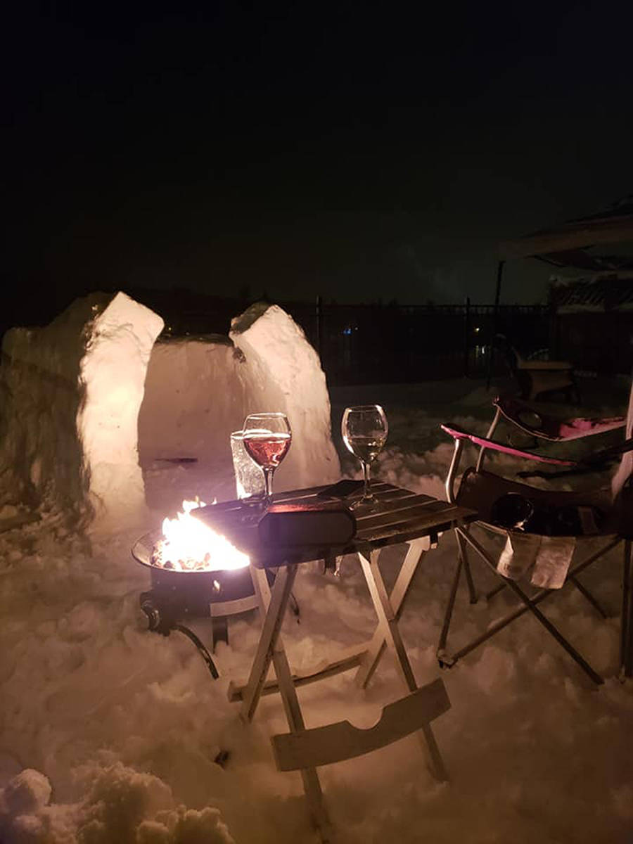 The couple used water to pack the snow into a recycling box, then used the ice bricks to craft the igloo. (Paul Lewis posted on Facebook)