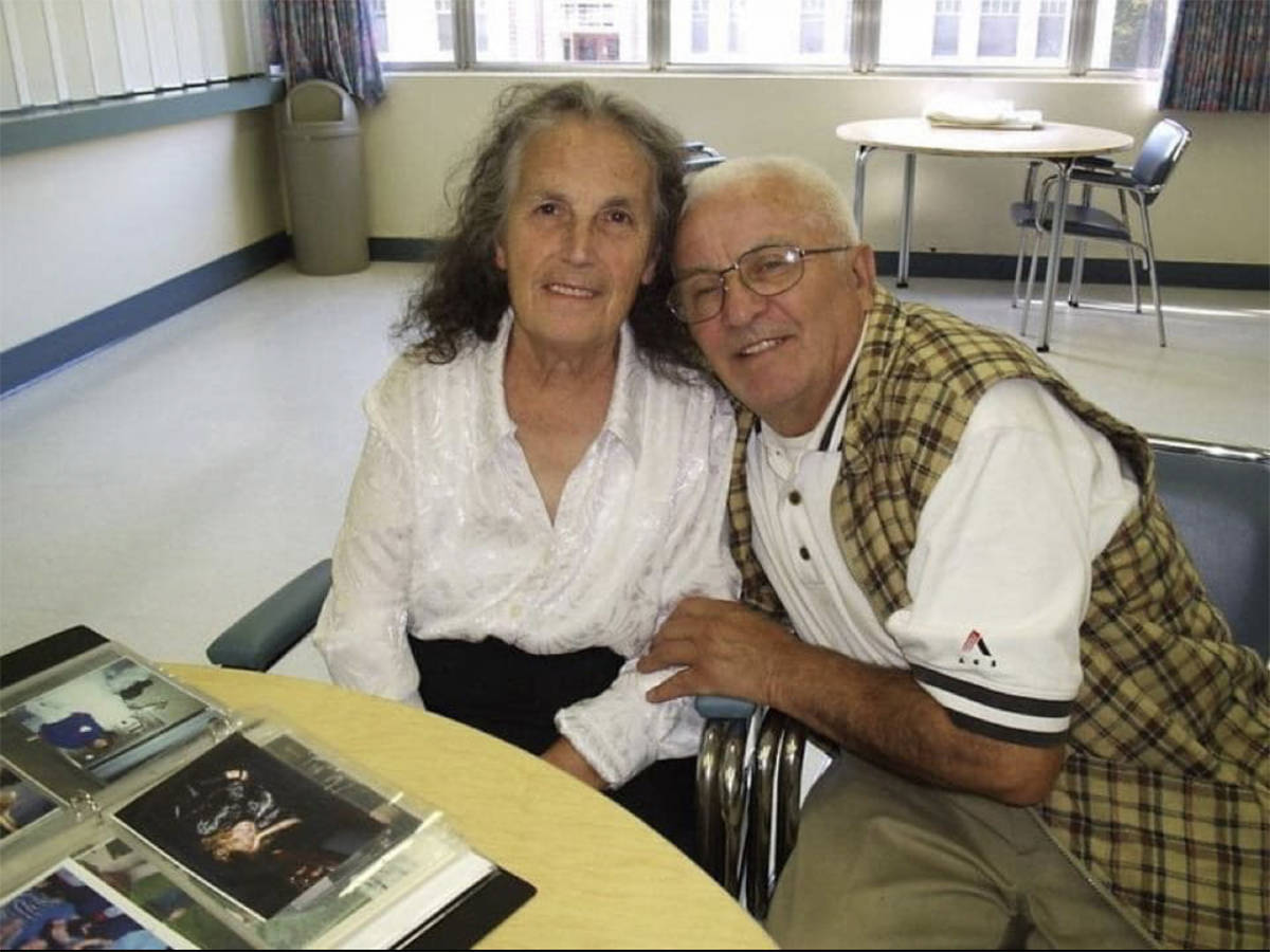 (Contributed)                                Jim and Tula 12 years ago, looking through photo albums, soon after she was diagnosed with dementia.