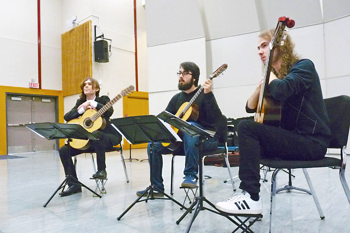 KPU music students (L to R) Alex Preuss, Robert Crews and Lucas McKennon took part in a guitar master class that preceded the Fraser Valley Acoustic Guitar Festival in Langley on Saturday. Dan Ferguson Black Press Media