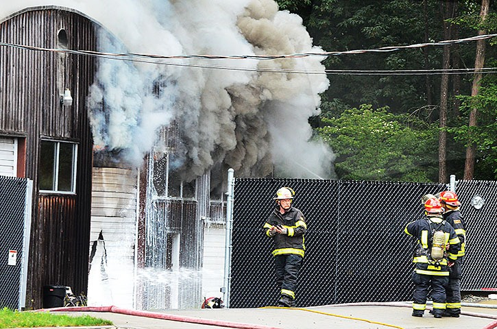 Langley Township fire crews battled a structure fire on the south side of Fraser Highway around 230th Street Thursday morning.