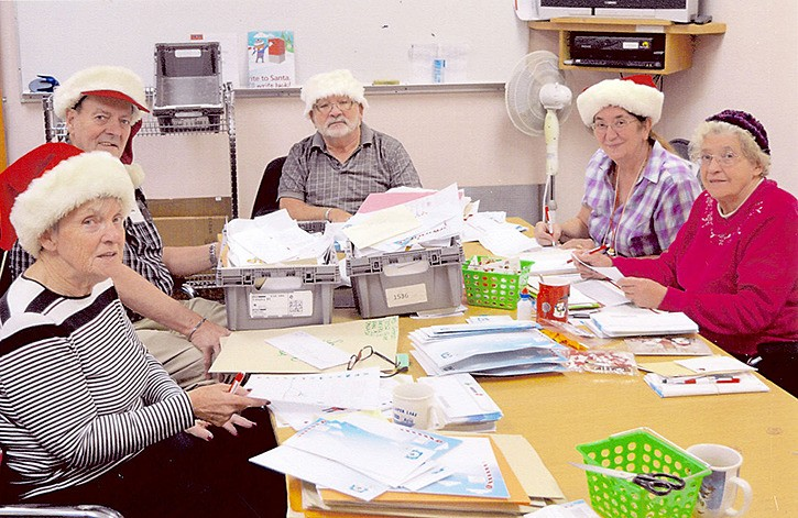 A team of experienced elves from Canada Post in Langley are helping sort and process letters to and from Santa.