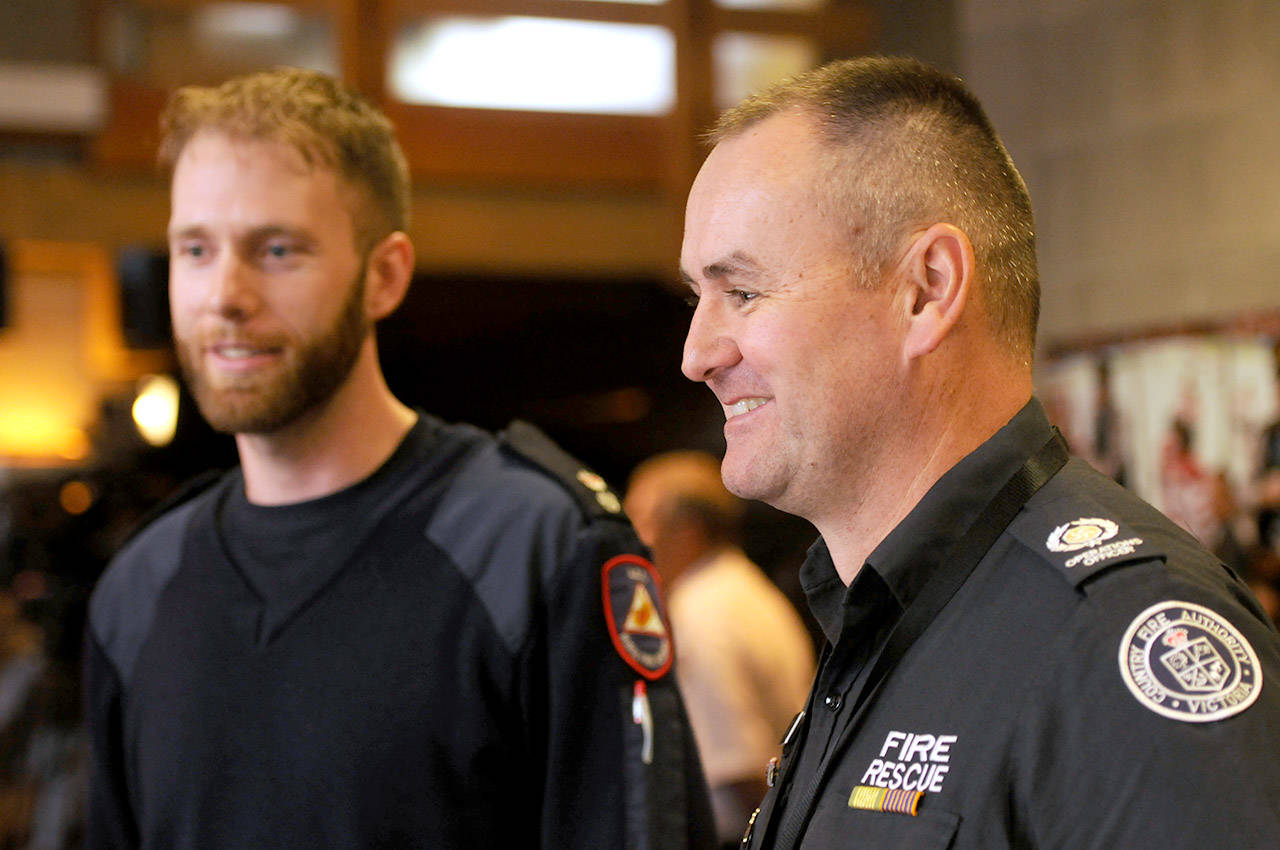 Wayne Riggs (right) and Paul Simakoff-Ellims are part of an Australian firefighting specialist team who are in B.C. to help with the province's wildfires. (Jenna Hauck/ The Progress)