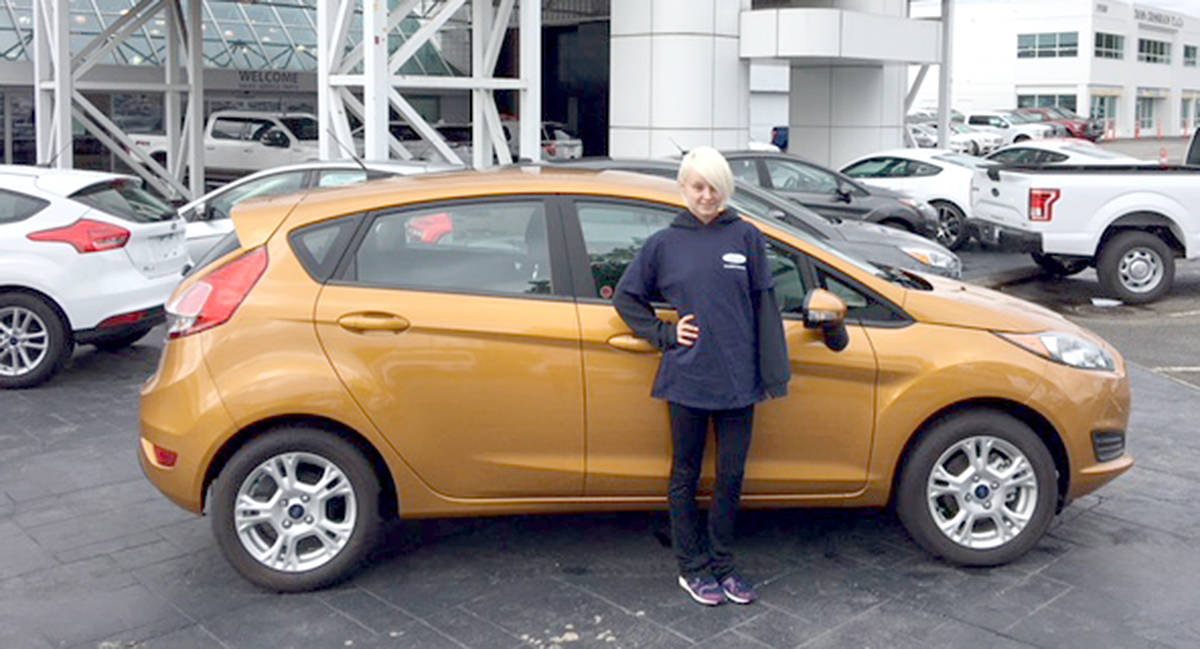 Team Ford Lincoln >> Langley Dealership Throws Support Behind Softball Team With