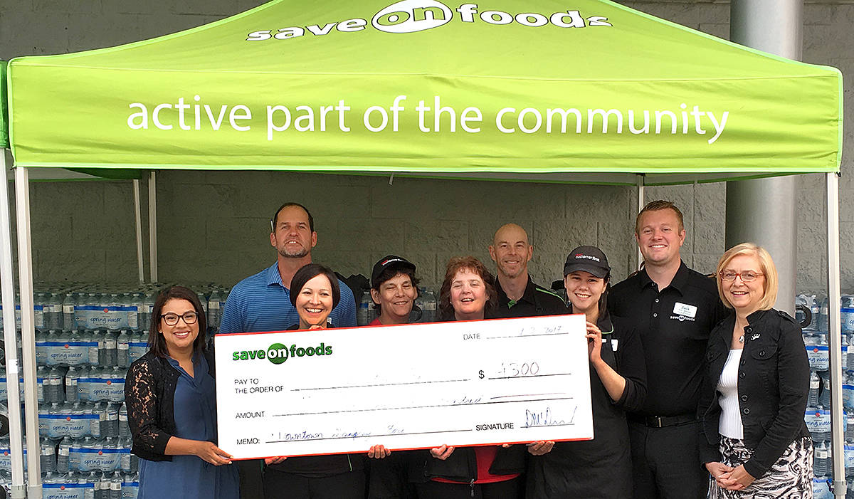 Langley City Save-On-Food's assistant manager Darren McDonald and David McClurg (back row) were on hand for a cheque presentation to Gateway of Hope. In the front row was Gateway executive director Emmy Skates, Save-On's Renee Lebeau, Joanne Runne, Brenda Clarke, Vanessa Verstraete, and store manager Zack Jones, as well as Evelyn Gut – from the Salvation Army's divisional headquarters. (Alison Linden/Langley Advance)