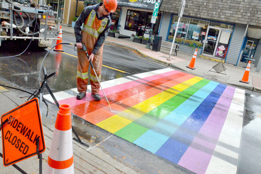 The Township is trying pressure washing to clean tire marks off the new rainbow crosswalk in Fort Langley.