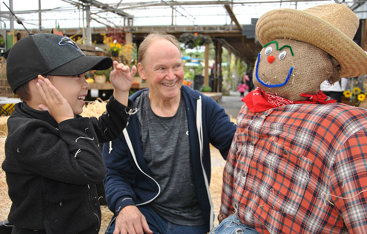 Four-year-old Max Pascual and his grandpa, Mike Broatch, both of Surrey, built a scarecrow named Jack. They joined grandma, Janice Broatch, and Max's little sister, Madi, in building Jack at the Art's Nursery in Port Kells. (Roxanne Hooper/Langley Advance)