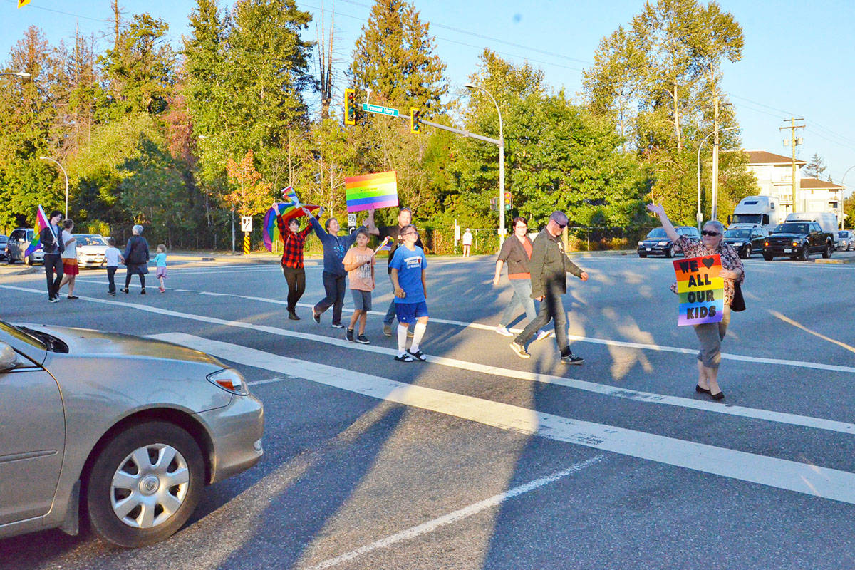 People at the rally on Sept. 26 carried signs and flags. (Heather Colpitts/Langley Advance)
