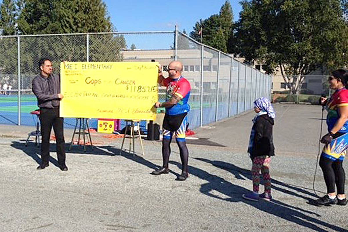 MEI is making a huge donation of more than $12,000 to this year's Cops for Cancer Tour de Valley. The team of cycling law enforcement officers stopped by the school Tuesday. (Special to the Langley Advance)