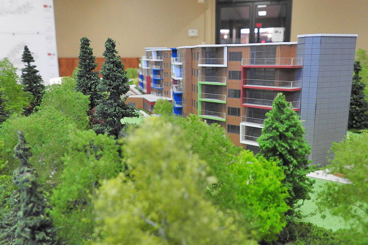 A model shows the two complexes on Old Yale Road and bounded on the south side by Murray Creek.