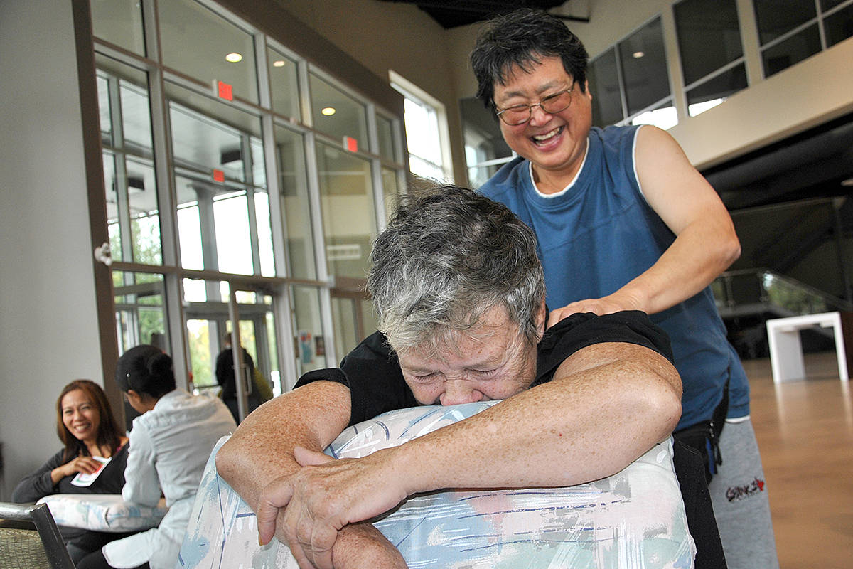 Pushing through 24 cars an hour – roughly – the Church in the Valley's recent Single Moms Oil Change had some grateful recipients. (Roxanne Hooper/Langley Advance)