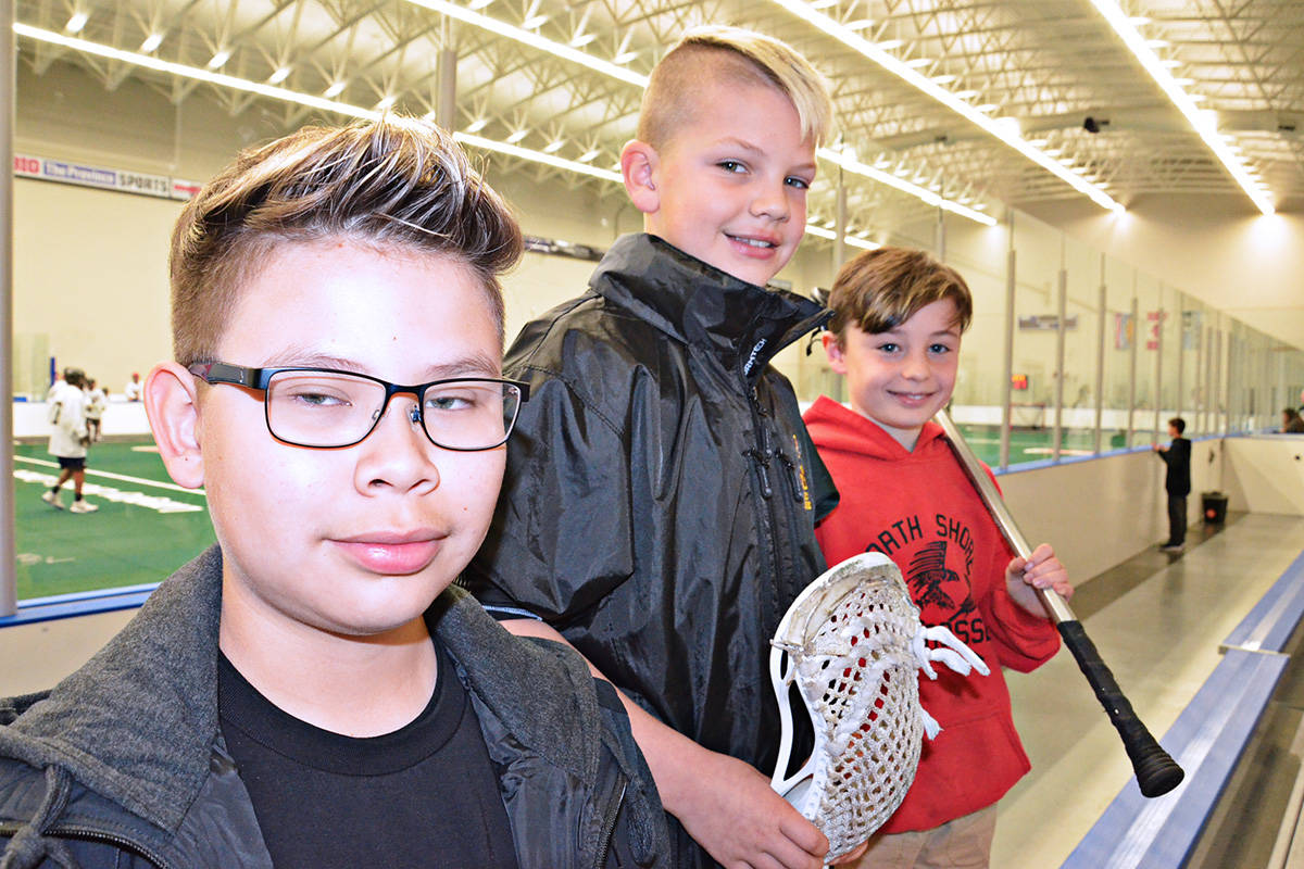 Young players Koru Joseph, Brandon Lyons and Case Latournis were in the stands at the Vancouver Stealth training camp in the Langley Events Centre fieldhouse. (Heather Colpitts/Langley Advance)