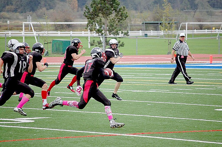 Langley Stampeders ball carrier Simon Odong headed to the Comox Valley Raiders' end zone for a touchdown during Sunday's midget football game at McLeod Stadium.
