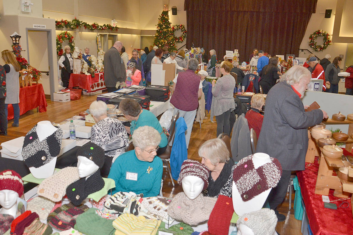 The Langley Seniors Resource Centre is a busy place as people check out the Christmas Craft Fair as well as visit Santa, enter raffles, and enjoy treats. (Heather Colpitts/Langley Advance)