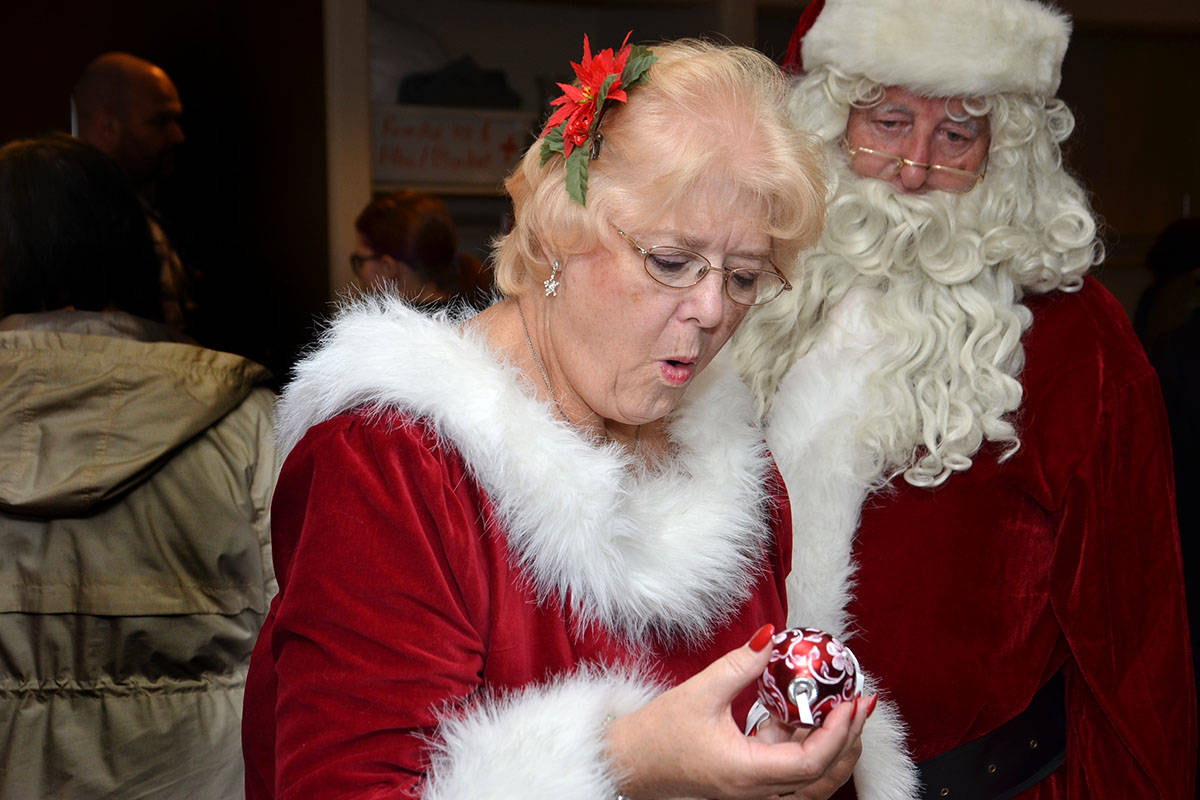Mrs. Claus and Santa wandered through the Langley Seniors Resource Centre Christmas Craft Fair on Nov. 25 before settling down in the auditorium to visit with kids of all ages. (Heather Colpitts/Langley Advance)