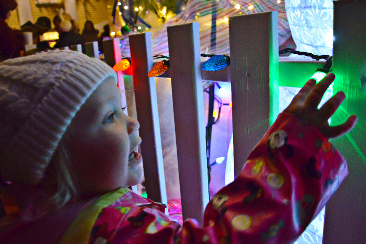 Sophia Disher, two, is now old enough to be enchanted by Christmas lights and was at the Fort Langley Christmas Tree Lighting on Saturday with her family. (Heather Colpitts/Langley Advance)