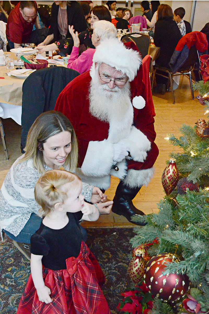 Santa met with Emma Milligan, almost two, and her mom Katie Milligan. (Matthew Claxton/Langley Advance)