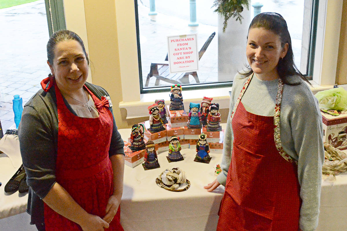 Erica Levitt and Michelle Gauvin oversaw the gift room at the Child Development Centre breakfast. (Matthew Claxton/Langley Advance)