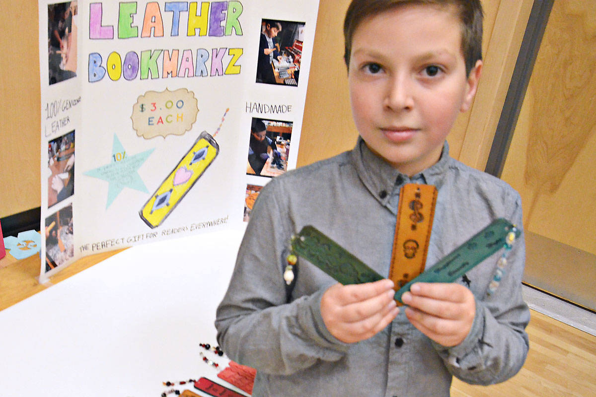 Grade 5 student Kayden Blissett learned leather work from his dad then fashioned bookmarks with intricate designs. (Heather Colpitts/Langley Advance)