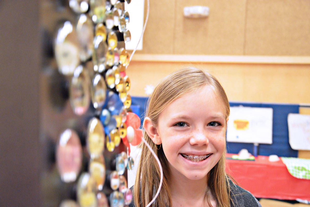 Grade 5 student Chloe Bowes made all manner of magnets for her business. (Heather Colpitts/Langley Advance)