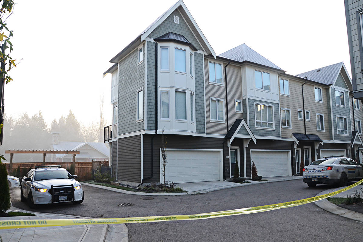 RCMP officers were on scene at a Langley townhouse complex where a fatal shooting took place Thursday night. (Matthew Claxton/Langley Advance)