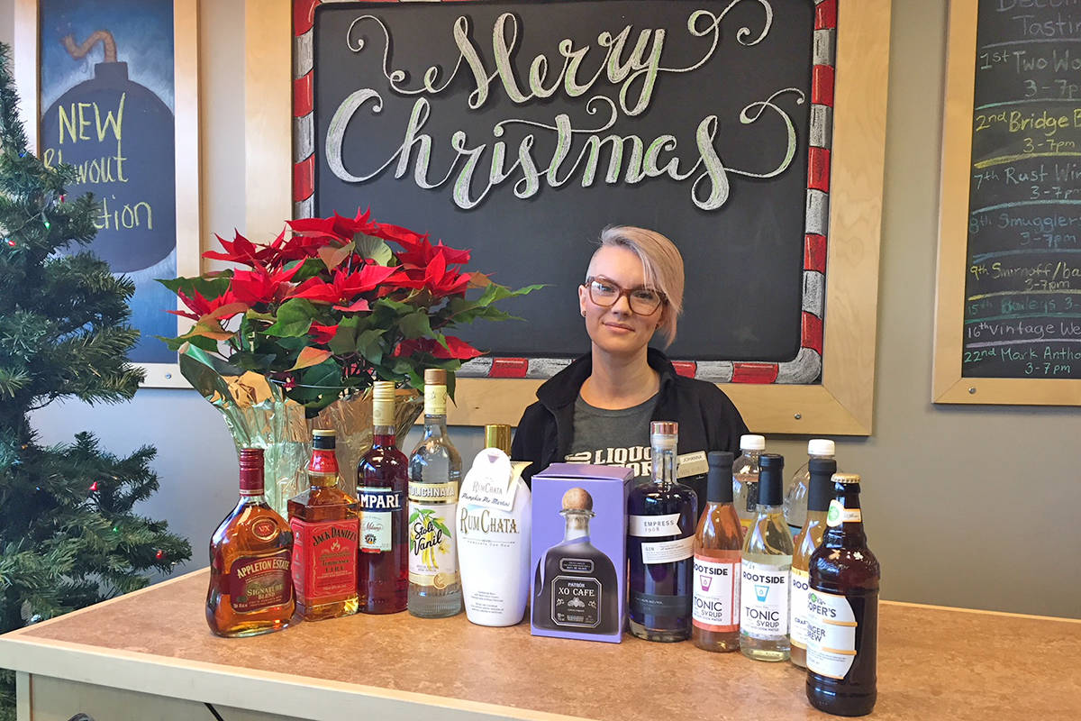 Johanna, from Langley's Brookside Liquor Store, showcases the ingredients to to craft the store's five go-to holiday-season cocktails.