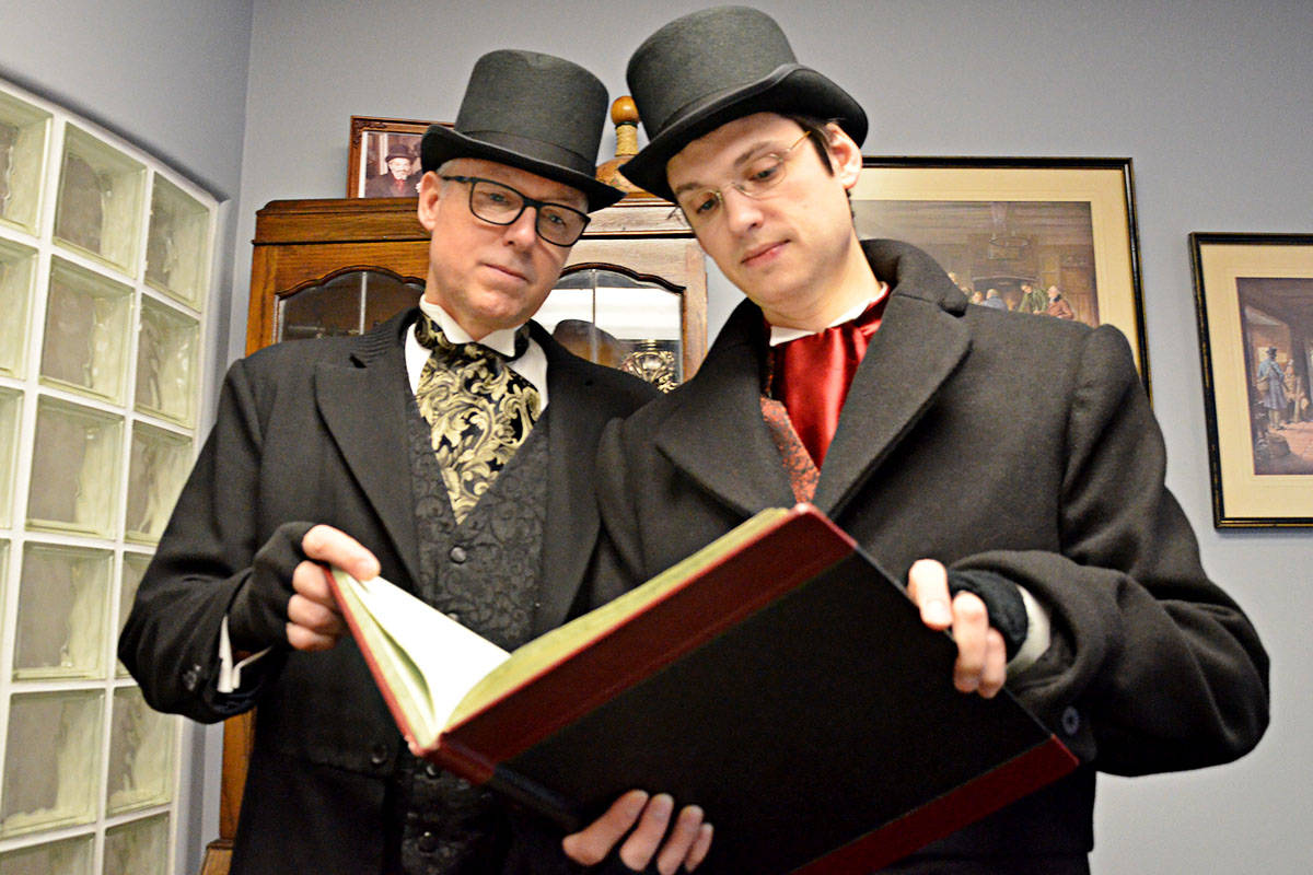 Is your business in Marley's good books? Wayne Kuyer (left) and Kyle Murray as Jacob Marley and Bob Cratchit are collecting for charity this Christmas season. (Matthew Claxton/Langley Advance)