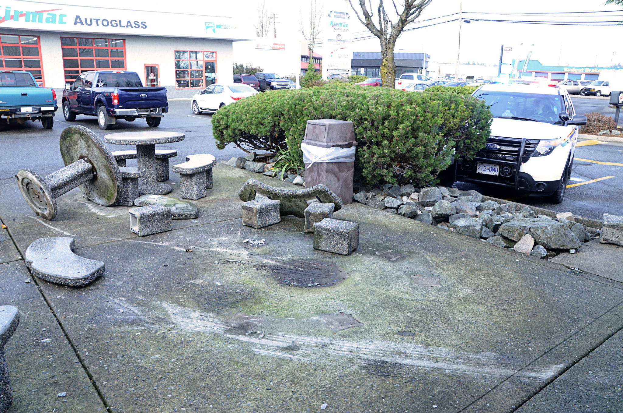 Concrete picnic tables were tossed around at Burger King on 200th Street on Tuesday morning. (Matthew Claxton/Langley Advance)