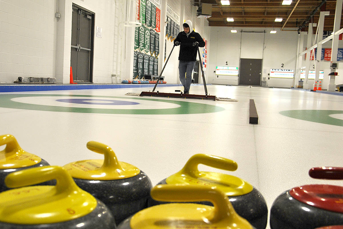 Rhett Hildenbrandt, a relatively new ice maker at Langley Curling Centre, is helping prepare the sheets of ice for provincial junior competitions next week. (Roxanne Hooper/Langley Advance)