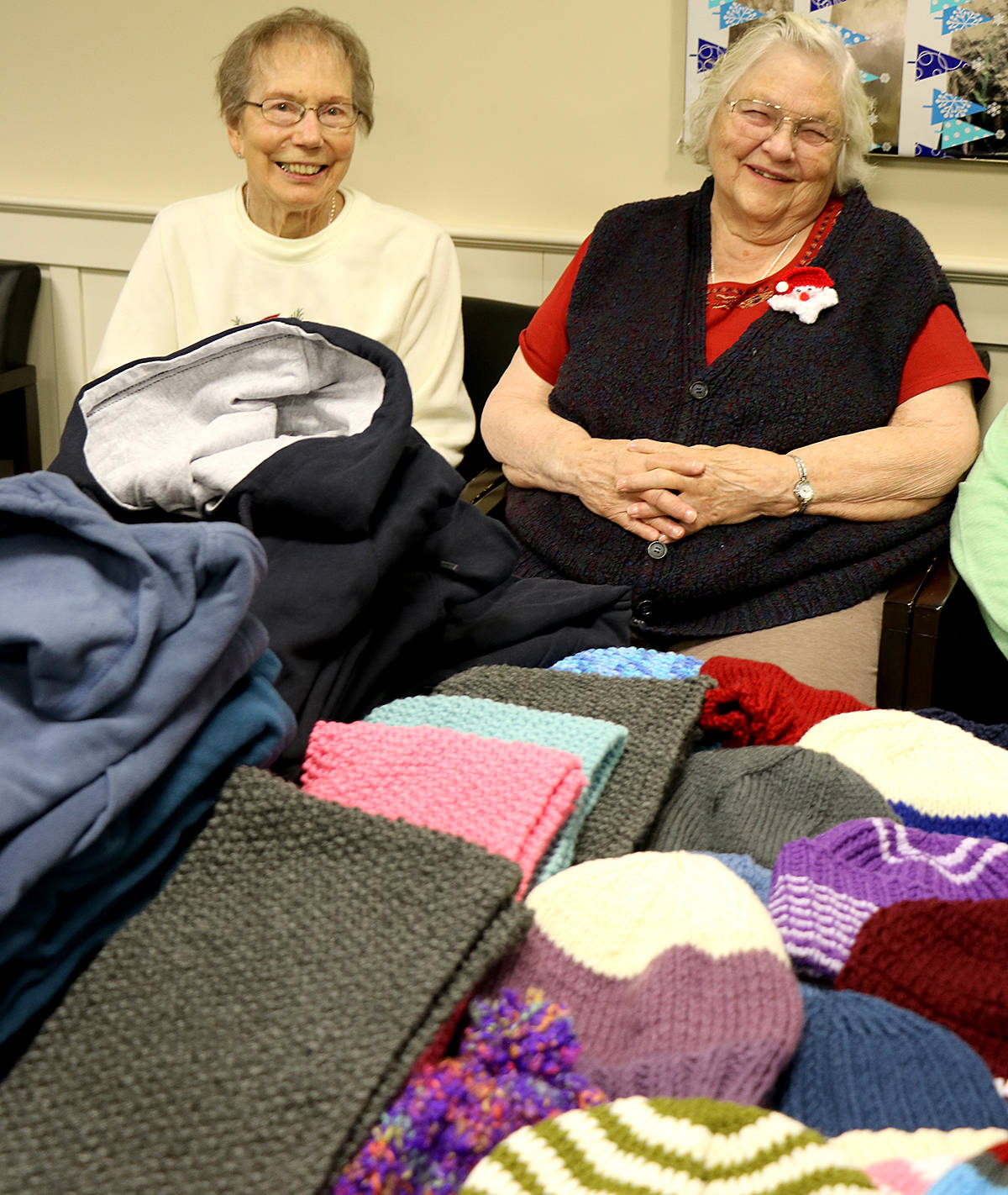 Residents from Langley Seniors Village, like Mildred Nichols and Maxine Olson, have been making and collecting warm clothing for the homeless for the past few months, as part of the annual Sock Granny campaign. (Special to the Langley Advance)