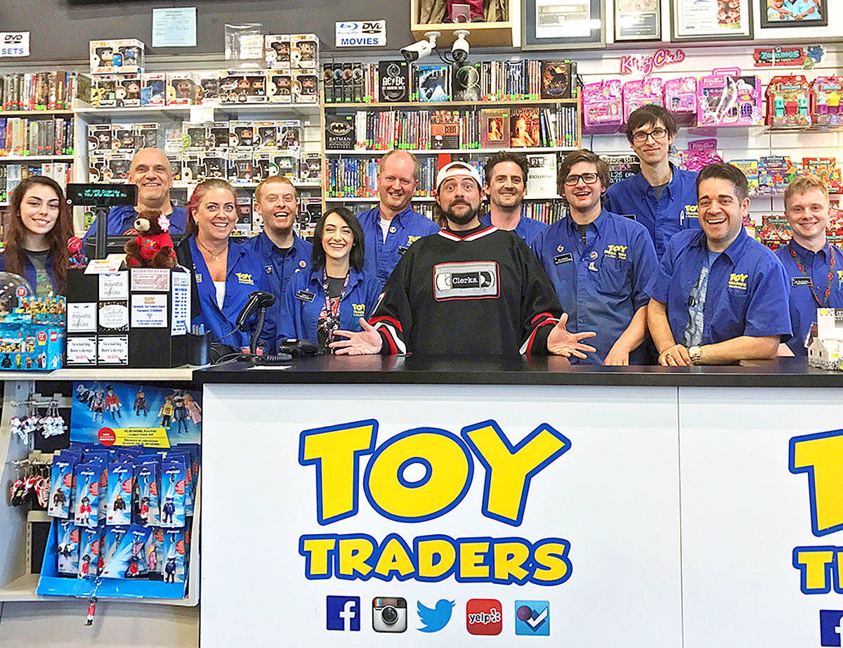Even supposed grown ups like filmmaker Kevin Smith (centre) likes to shop at Toy Traders in Langley for his toys and collectibles. (Special to the Langley Advance)