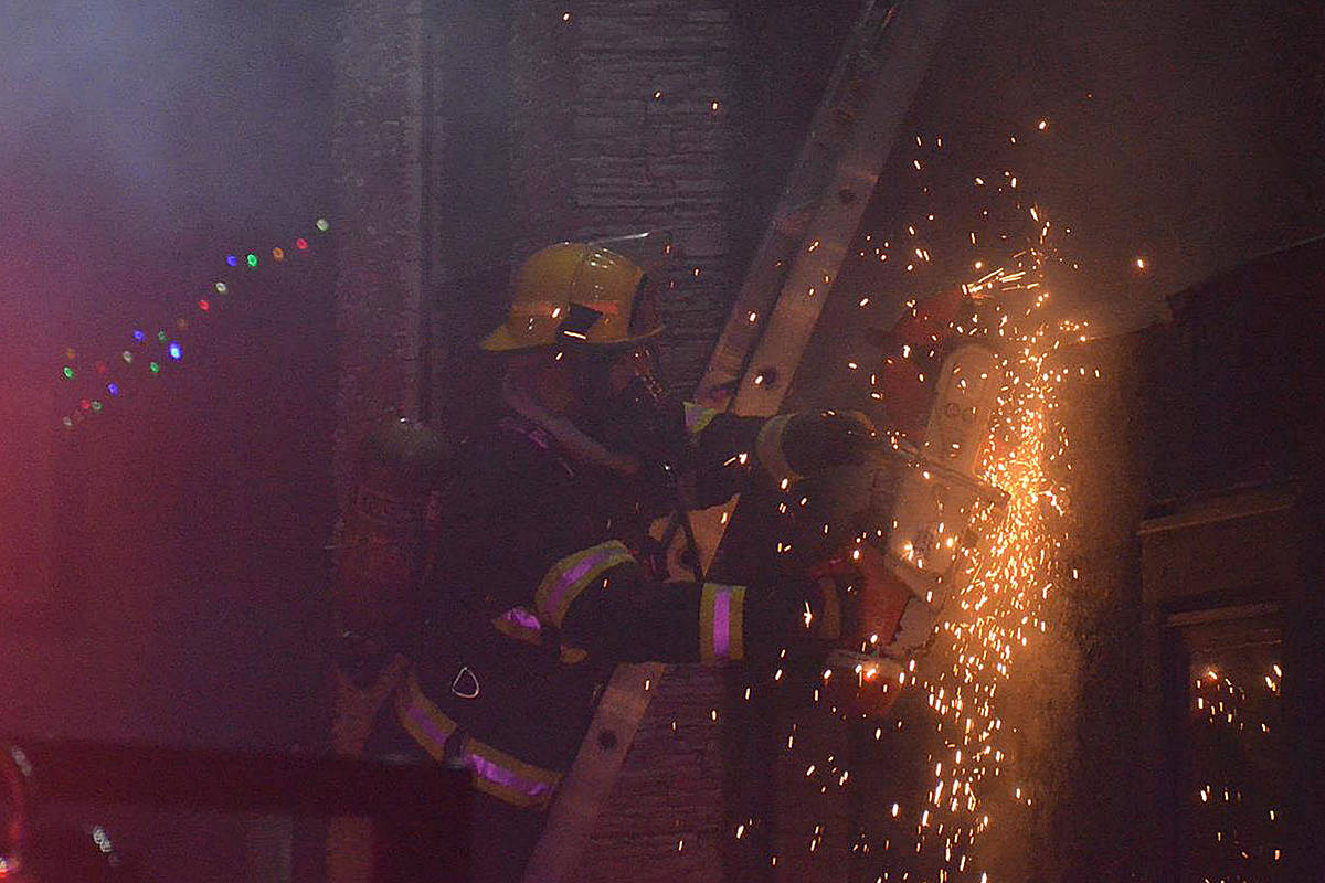 Saws were used to cut into the wall and extinguish a fire in a Willoughby home late Friday night.(Curtis Kreklau/South Fraser News Services)