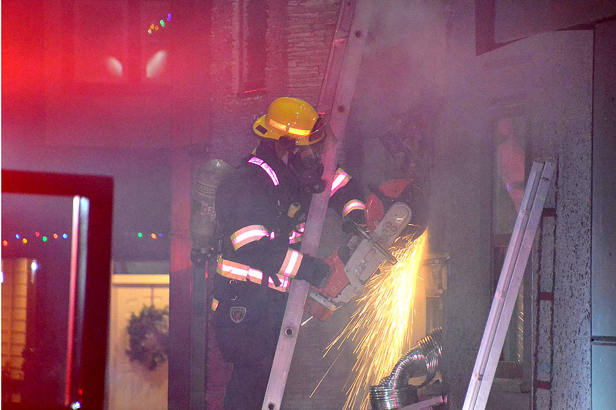 VIDEO: Neighbours fought to extinguish Langley house fire