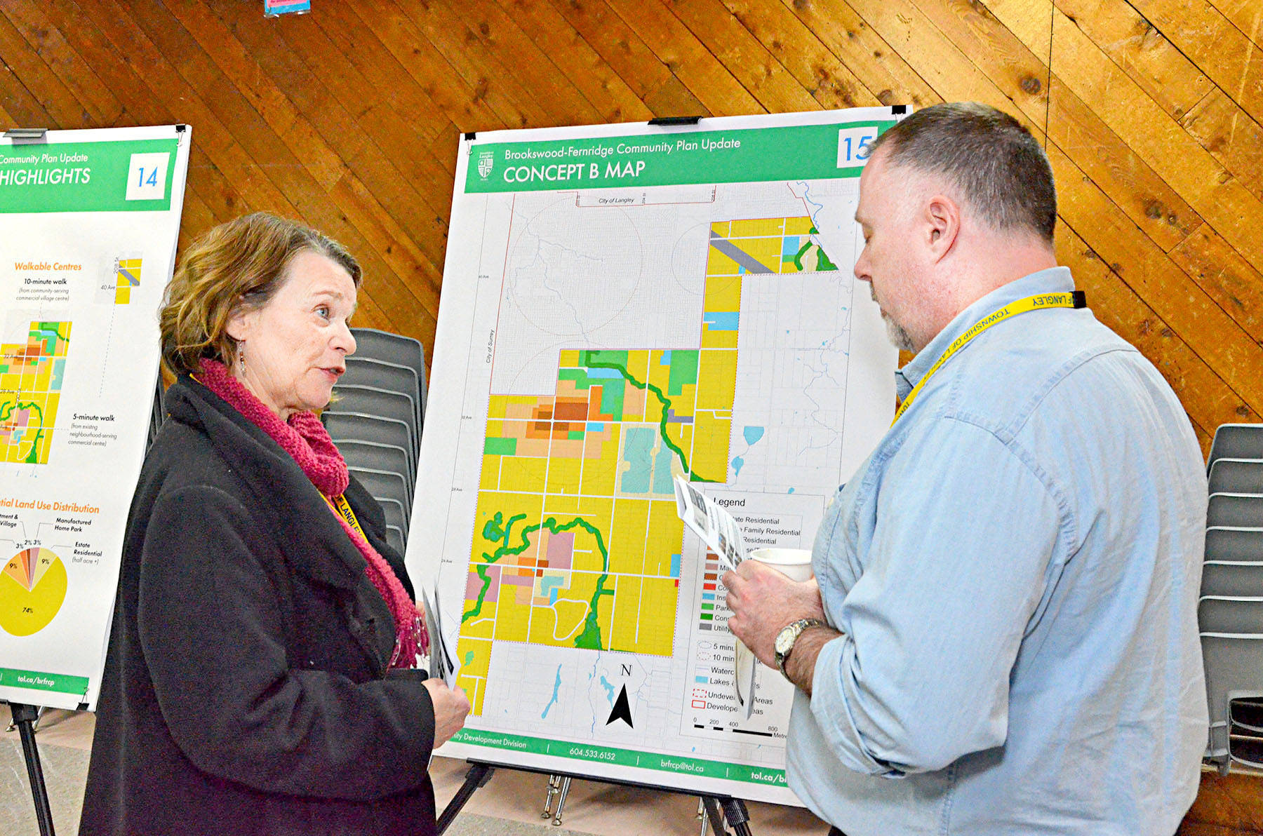 Councillor Petrina Arnason and a Township staffer talked about the map of possible land uses at a March open house. (Langley Advance files)